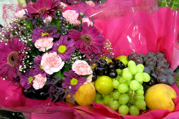 Give it to him. Fruit and Flower Basket