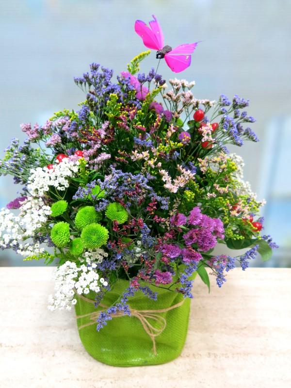 Centro de flores vintage en recipiente de tela - Foto 3
