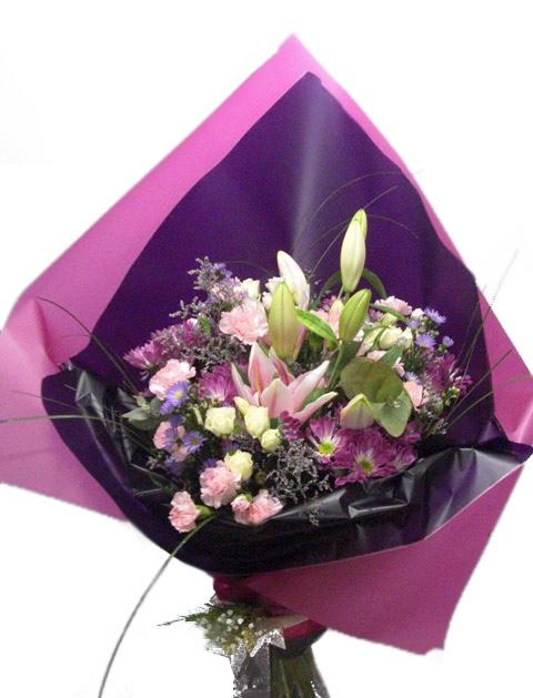 Ramo de flor variada en tonos rosas y lilas - Foto principal