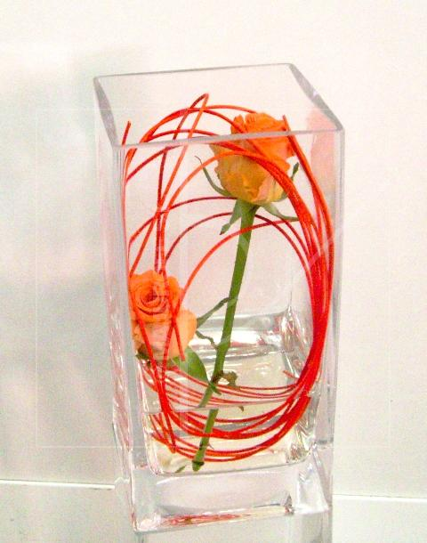 2 Rosas en centro de cristal de color naranjas